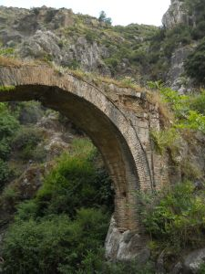 Ancient bridge crossing the flowing tears of Niobe