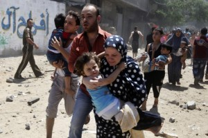 Palestinian families fleeing Israeli air strikes in Gaza