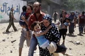 Palestinian families fleeing Israeli air strikes in Gaza
