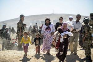 Syrian Kurds crossing the border into Turkey