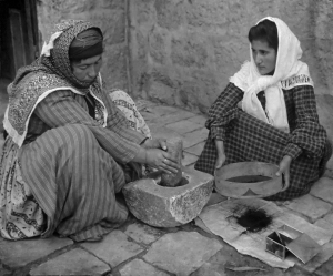 Palestinian women grinding coffee in happier days