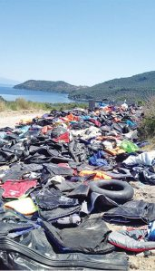 Abandoned boats and clothing on the coast of Lesvos