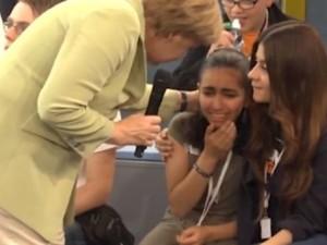 Frau Merkel 'consoling' a Palestinian refugee