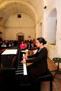 Eren Levendoğlu playing in the old Gümüşlük church