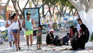 Asylum-seekers from Syria wait in Bodrum, Turkey