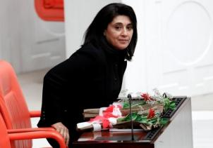 Pro-Kurdish lawmaker Leyla Zana takes her seat as she arrives at the Turkish Parliament in Ankara