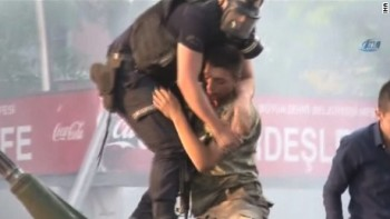 160716023423-03-turkey-coup-soldier-pulled-to-safety-by-police-large-169