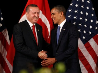 U.S. President Obama shakes hands with Turkey's PM Erdogan in Seoul