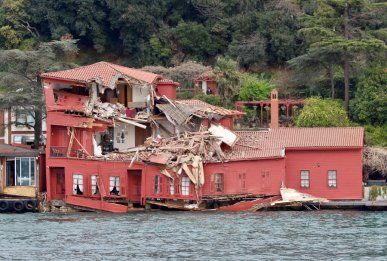 The damaged Hekimbasi Salih Efendi Mansion is seen after the Maltese flagged tanker Vitaspirit crashed into it by the Bosphorus strait in Istanbul